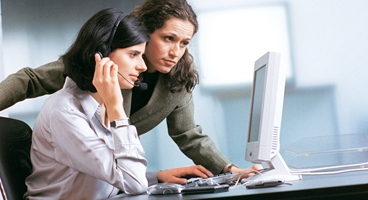 Two business women with computer in an office